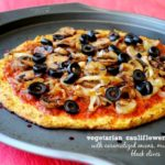 Vegetarian Cauliflower Crust Pizza with Caramelized Onions and Mushrooms