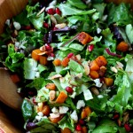Easy Thanksgiving Salad - romaine, roasted butternut squash, pomegranate seeds and an orange cinnamon vinaigrette that shakes up easily in a jar.