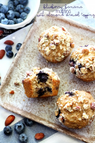 Whole grain blueberry banana muffins filled with plump juicy blueberries and covered with a sweet almond streusel topping! These muffins are a MUST make and so perfect for Easter brunch!