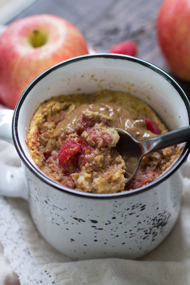 If you're looking for a delicious, easy, mess-free morning meal, you're going to love this recipe for Raspberry Apple Microwave Baked Oatmeal in a Mug.