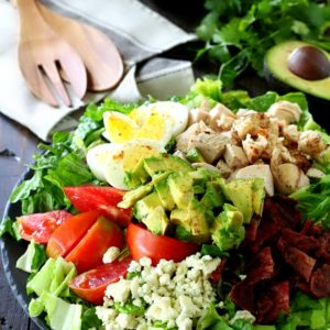 This Healthy Chicken Cobb Salad has all of the goodness you remember from the classic cobb salad, but the flavor is kicked up in a major way!