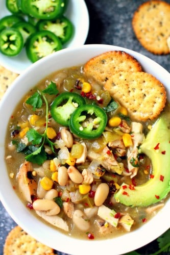 A flavorful Skinny White Chicken Chili that makes you feel warm from the inside out and is so perfect served during the winter season! gluten-free & dairy-free