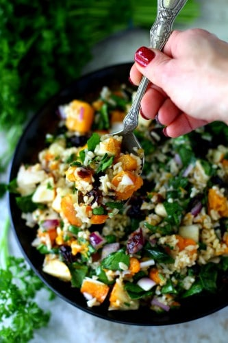This vibrant Roasted Butternut Squash Brown Rice Holiday Salad is full of flavor and texture with fresh pear, chewy dried cranberries, sweet caramelized roasted butternut squash, hearty brown rice and a sweet-tangy apple cider vinaigrette! (vegan & gluten-free)