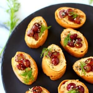 Roasted Grape Caramelized Onion Hummus Crostini