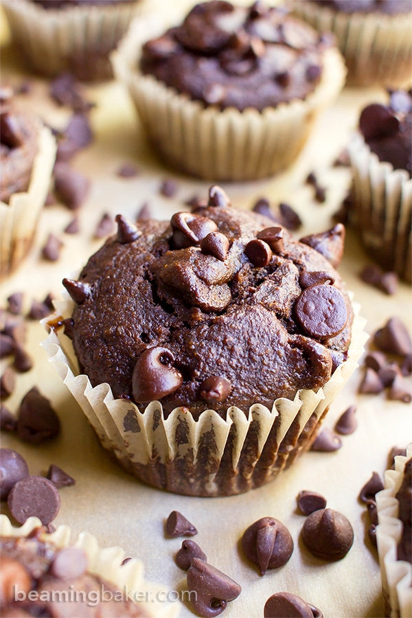 A one bowl recipe for moist, rich chocolate banana muffins dotted with chocolate chips.