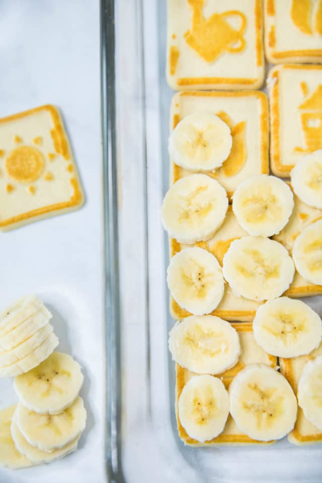 topping cookies with banana slices for banana pudding