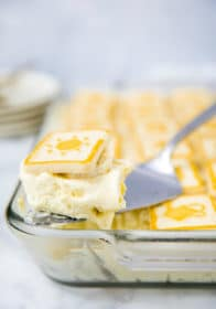 a serving of banana pudding being dished out on a serving spoon