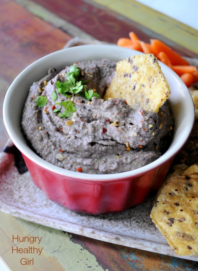 Spicy Black Bean Hummus- a super easy and healthy dip that pairs perfectly with crackers, chips and/or fresh veggies.