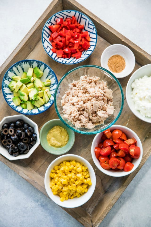 ingredients for tuna salad in small bowls
