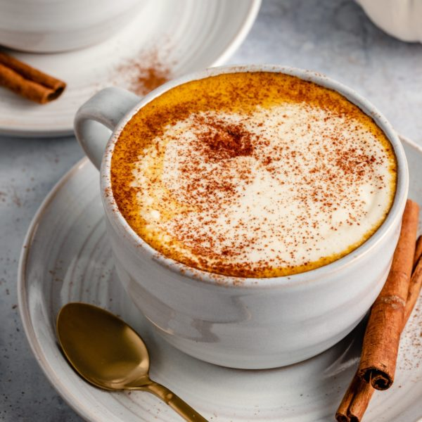 mug of coffee with pumpkin spice creamer and froth on top