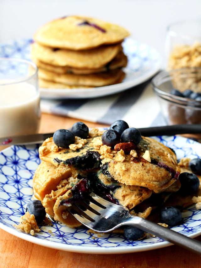 Fluffy gluten-free pancakes with plump juicy blueberries made even more scrumptious with crunchy granola!