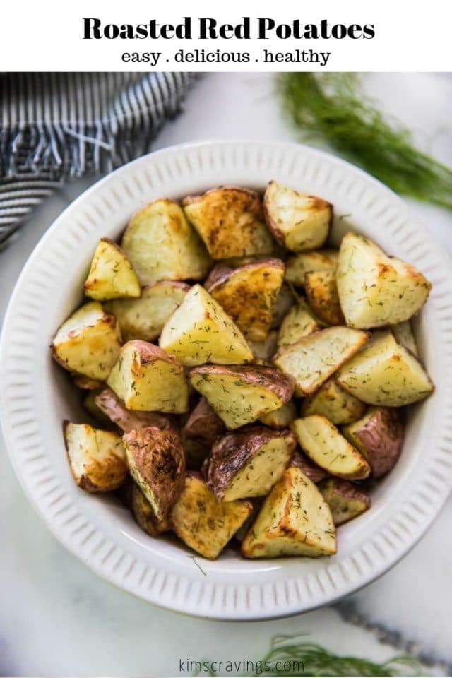 roasted red potatoes in a white serving bowl