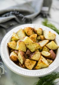 roasted red potatoes in a white bowl