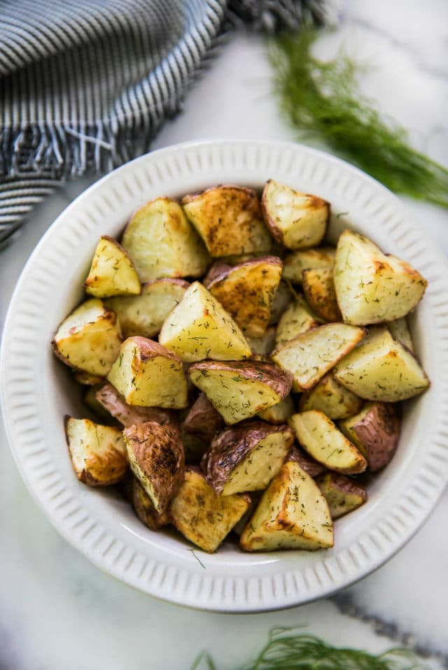cubed potatoes, seasoned and served in a white bowl
