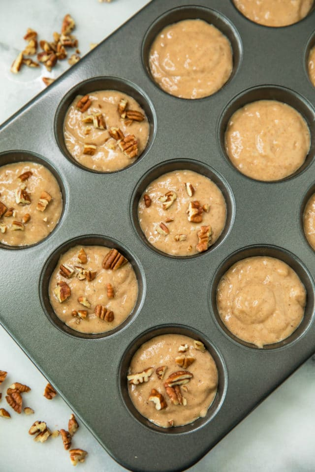 Banana Nut Protein Muffins in a muffin pan before being baked