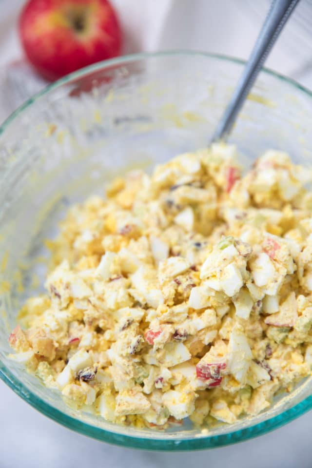 egg salad mixed in a large glass bowl