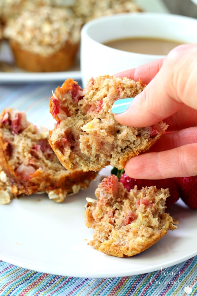 Strawberry Banana Whole Grain Muffins filled with juicy strawberries and covered with a sweet oat streusel topping! These muffins are a MUST make!