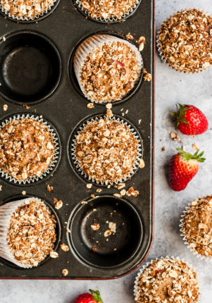 strawberry muffins with oat topping in a muffin pan