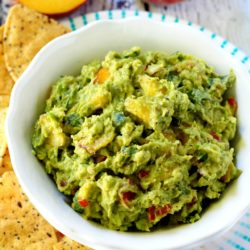 Easy peach guacamole is a simple, yet dazzling, twist on the typical guacamole.
