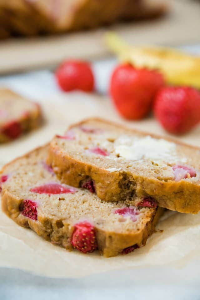 Slices of strawberry bread served with butter