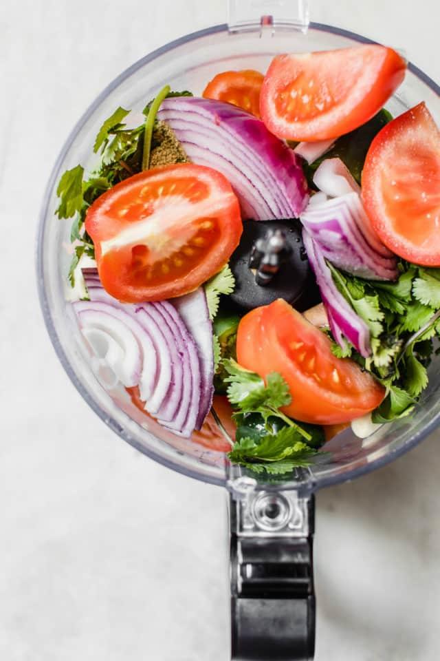 chopped tomato, onion, and cilantro in a food processor