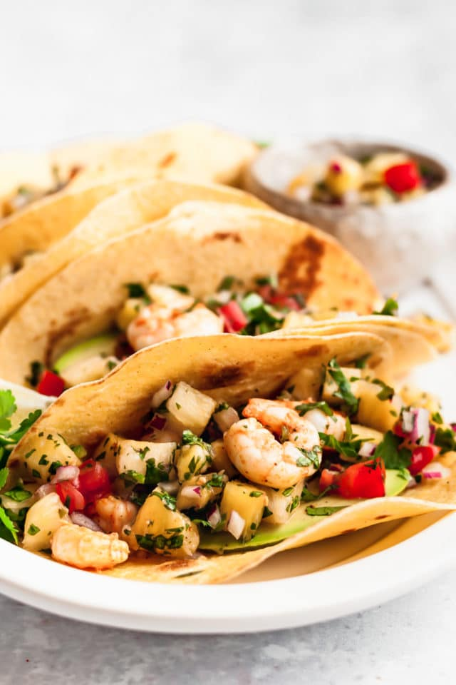 soft tacos filled with shrimp and pineapple salsa