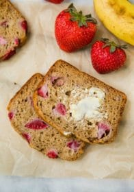 Whole Grain Strawberry Banana Bread with butter spread on top
