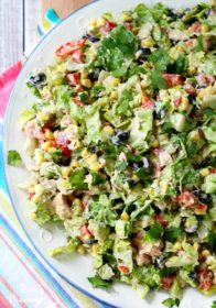 Mexican Chopped Tuna Salad- protein-packed tuna combined with chopped romaine, black beans, bell pepper, olives, sweet yellow corn, fresh tomatoes, avocado and a creamy taco-flavored dressing makes for the most incredibly tasty yumilicious tuna salads!