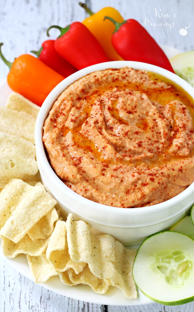Roasted Tomato Hummus- a creamy, delicious, mild tasting hummus with flavors of summer. Dip it, spread it on sandwiches or use it as a salad topping.