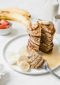banana oat pancakes with a bite on a fork