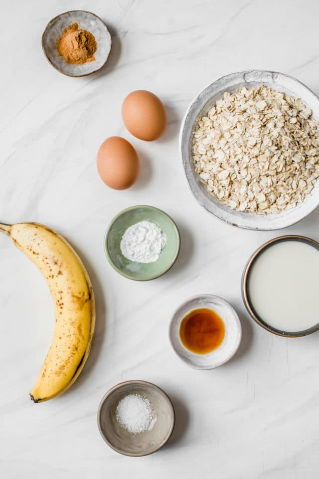 banana, eggs, oats and all other ingredients to make banana oatmeal pancakes
