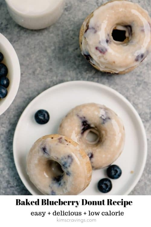 blueberry donuts with glaze on a white plate