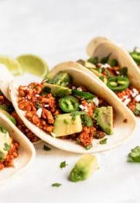 healthy soft tacos with avocado, jalapeño and cilantro