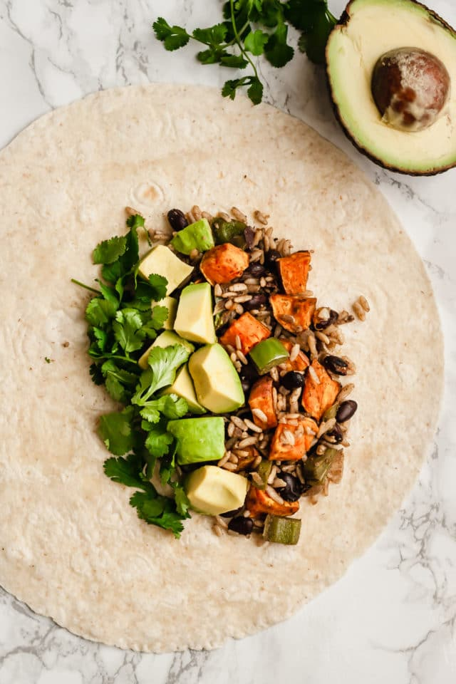 tortilla filled with sweet potato, black beans and avocado