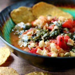 close up side image of Easy Spinach Tomato Cannellini Bean Soup served with chips