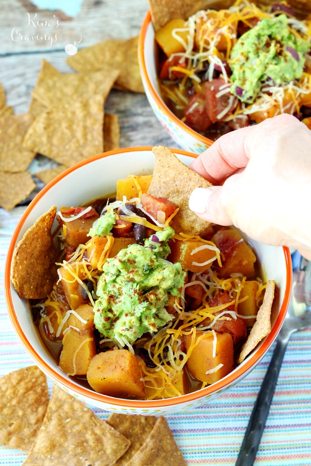 Vegan Butternut Squash Chili- savory, fresh, slightly spicy chili takes a cozy cue from fall with a Southwestern twist you're sure to love. This satisfying chili is packed with so much flavor and texture, carnivores and herbivores will be all over this one.