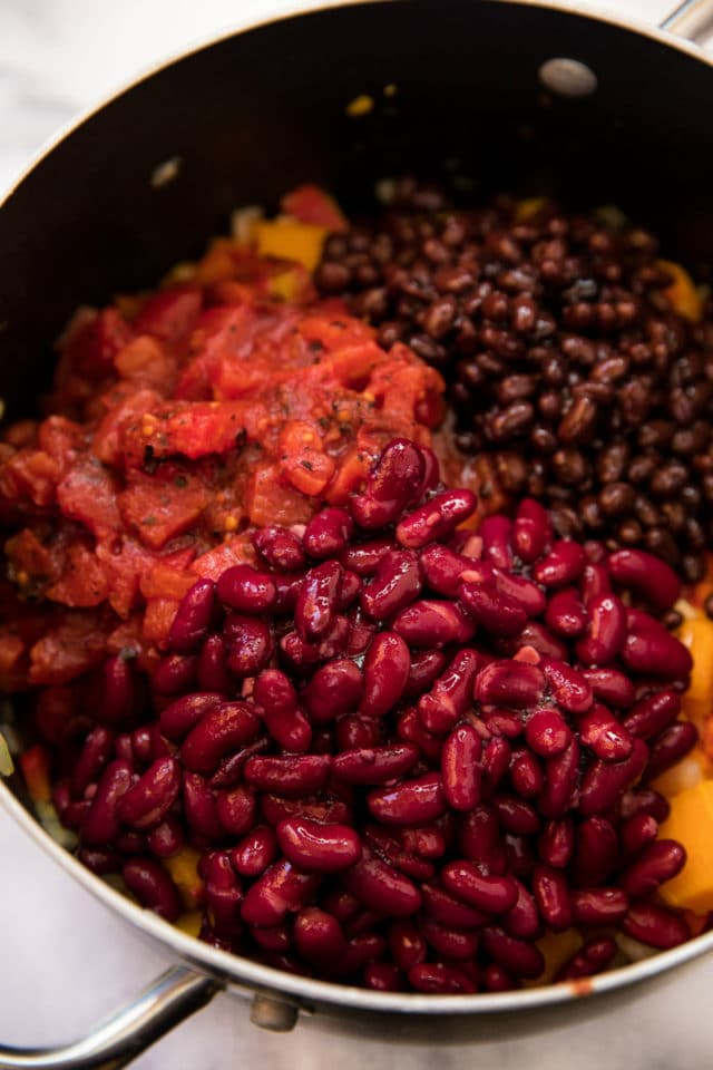 ingredients for vegan chili in a large pot