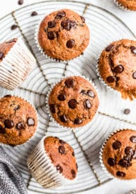 Chocolate Chip Pumpkin Muffins on a wire cooling rack