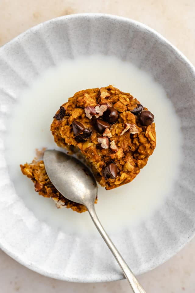 pumpkin oatmeal muffin served in a bowl with milk
