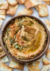 Pumpkin hummus topped with pumpkin seeds, paprika and olive oil