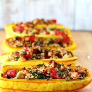 Roasted delicata squash brimming with lean turkey, nutritious spinach and juicy tomatoes makes for an incredibly delicious fall meal- this super simple stuffed delicata squash is a must try! (gluten-free & Paleo)