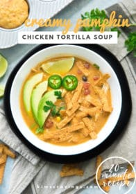 creamy pumpkin chicken tortilla soup in a white bowl