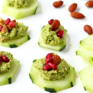 Easy Hummus Cucumber Bites- fresh crisp cucumber topped with flavorful hummus, crunchy almonds and sweet pom seeds makes for an irresistible finger food.