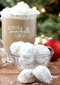 Almond Snowball Cookies served in a glass bowl with a coffee drink