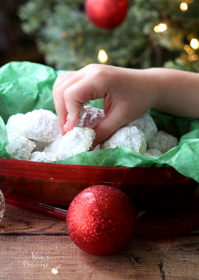 Packed with a lovely almond flavor and dusted with powdered sugar, delicate Almond Snowball Cookies are a family favorite Christmas cookie and perfect for holiday gift-giving.