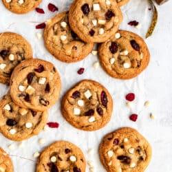 white chocolate cranberry Christmas cookies near Christmas ribbon