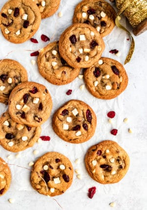 white chocolate cranberry Christmas cookies near Christmas ribbon