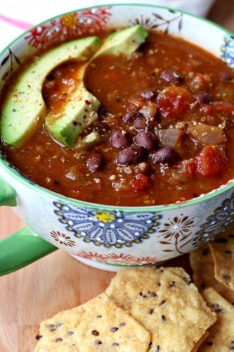 an easy 30 minute chili recipe perfect for lazy snow days, inside by the fireplace! You won't believe how incredibly flavorful this quick and easy chili tastes. Serve with cornbread or tortilla chips, wrap your hands around the bowl and let the chili deliciousness warm you from the inside out!