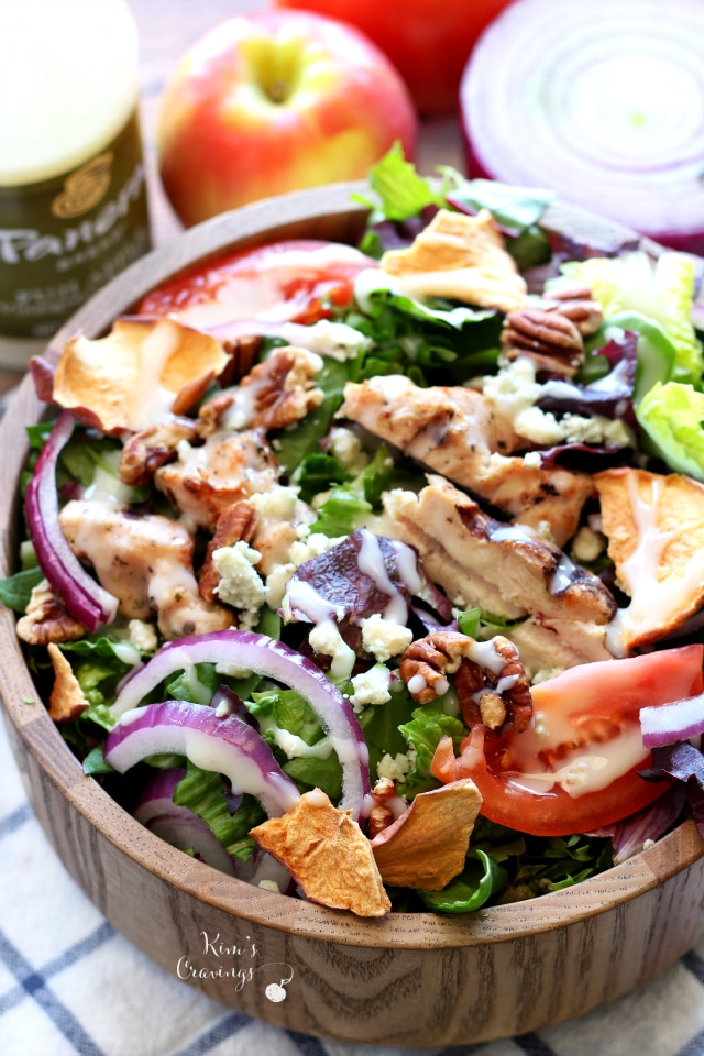 apple chicken salad served in a wooden bowl