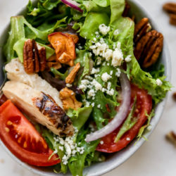 apple chicken salad with red onion, pecans, and tomato